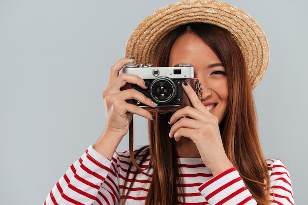 Close up image of carefree asian woman in sweater