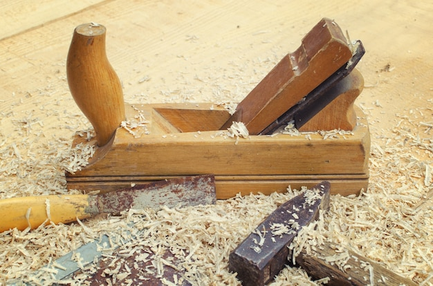 Close up image of chisel and carpentry tools used for wood work