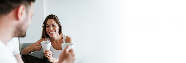 Close-up image of couple drinking cup of coffee or tea.