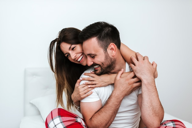 Close-up image of couple hugging and cuddling.