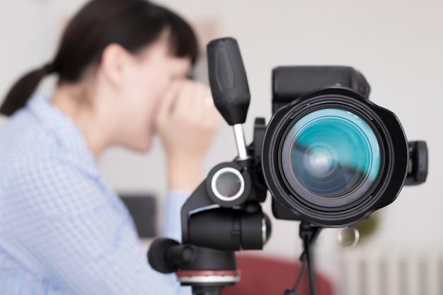 Close up image of dslr camera on tripod