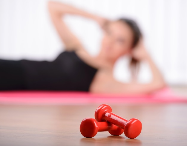 Close up image of dumbbell lying on the floor.