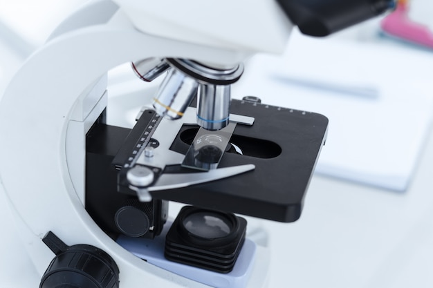 Close-up image of a microscope with a sample on a table in the laboratory. photo with a copy-space.
