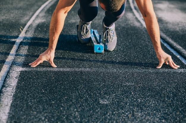Close up image sprinter legs on the start