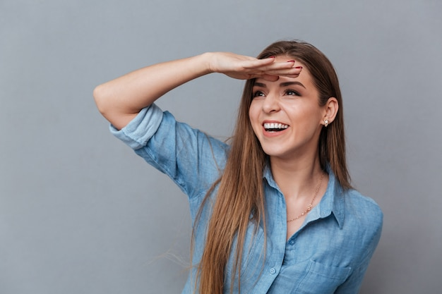 Close up image of woman in shirt looking away