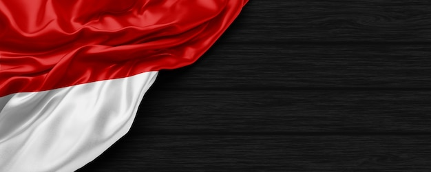 Close up of indonesia flag on the black wooden background 3d render