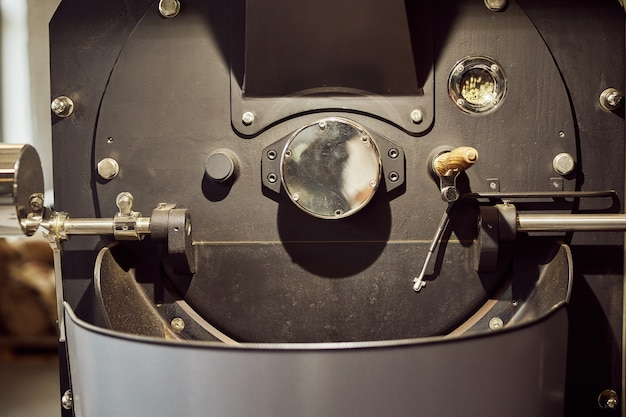 Close up of industrial equipment for roasting and cooling coffee beans