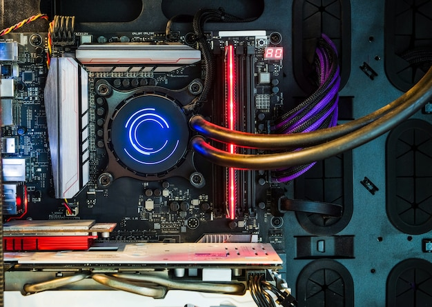 Close-up and inside desktop pc gaming and cooling fan cpu with multicolored led rgb light show status on working mode