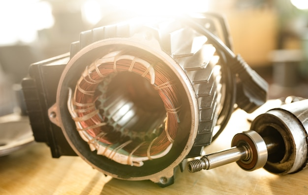 Close-up of an iron industrial motor lies on a table during the production of new modern trucks in a factory. the concept of reliable and high-quality special cars