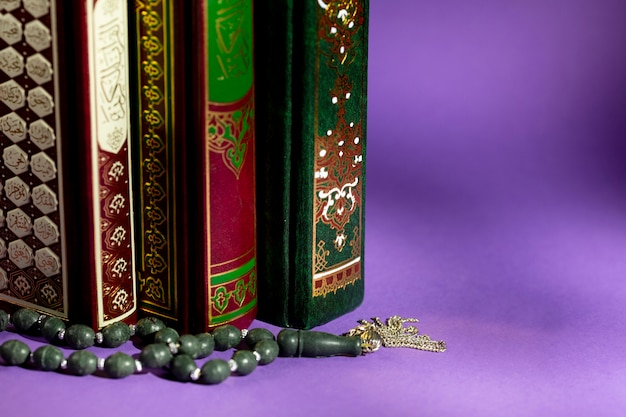 Close up of islamic books and prayer beads