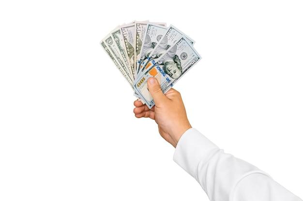 Изолированный крупный план, деньги в руке мужчины. на белом фоне.