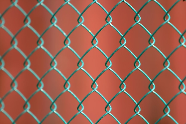 Close-up of isolated painted simple geometric black iron metal wire chain link fence
