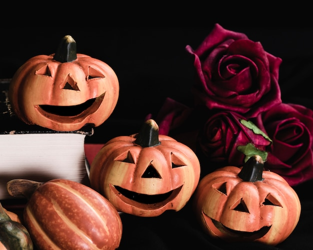 Close-up of jack-o'-lanterns and roses
