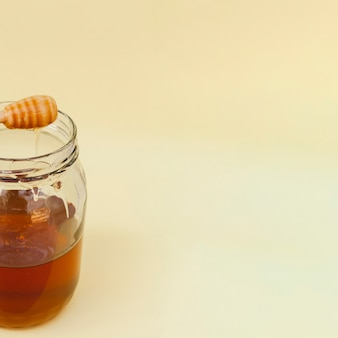 Close-up jar filled with homemade honey