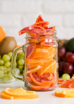 Close-up jar with grapefruit slices on the table