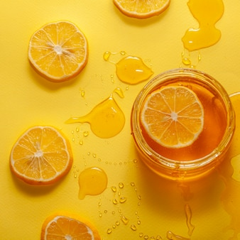 Close-up jar with honey and lemon