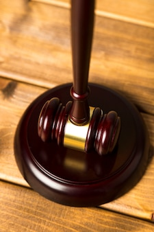 Close-up judge gavel with striking block