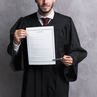 Close-up judge pointing at contract