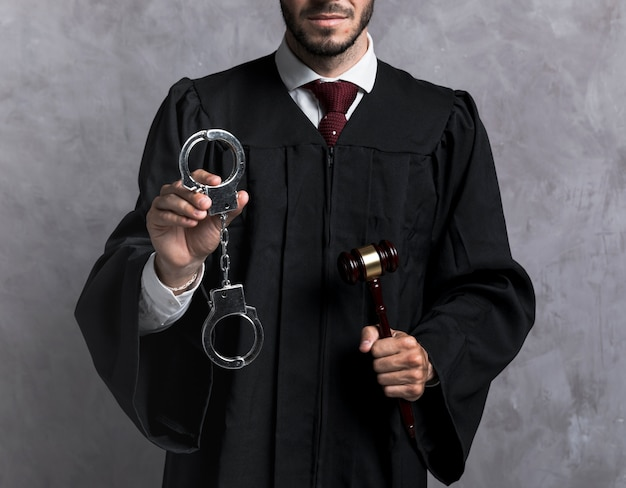 Close-up judge with handcuffs and gavel