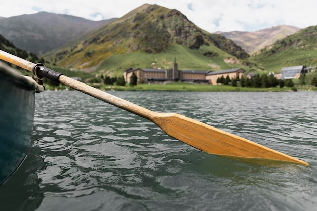 Close up on kayak canoe paddle in the river