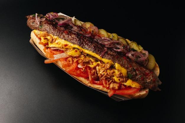 Close up of kebab sandwich on black black background