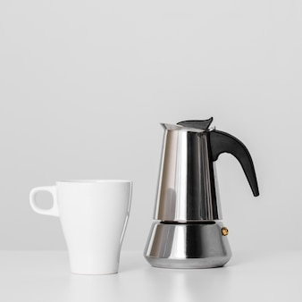 Close-up kettle and ceramic mug