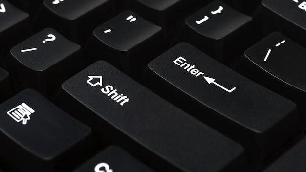 Close up of keyboard of black laptopenter