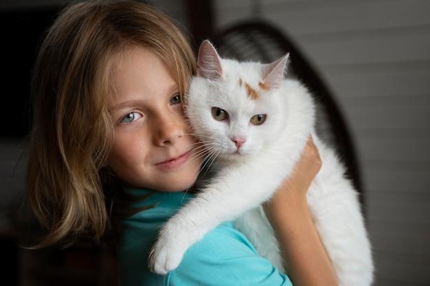 Close up kid holding cat