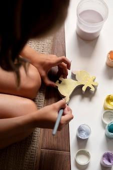 Close up kid painting at home