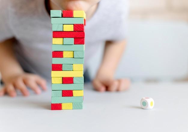 Close-up kid playing jenga