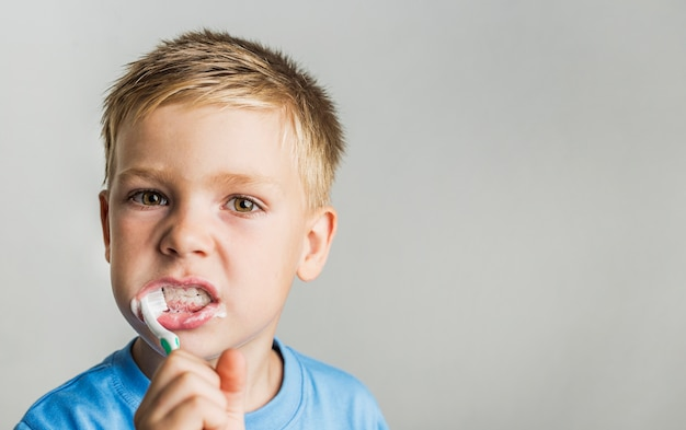 Close-up kid teeth brushing