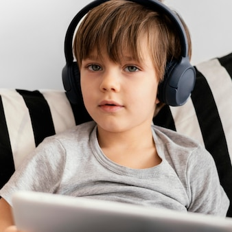 Close-up kid wearing headphones