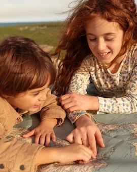 Close-up kids looking at map