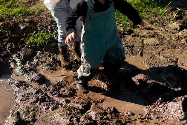 Close up kids playing in mud