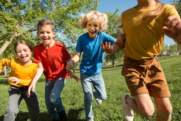 Close up kids running as team
