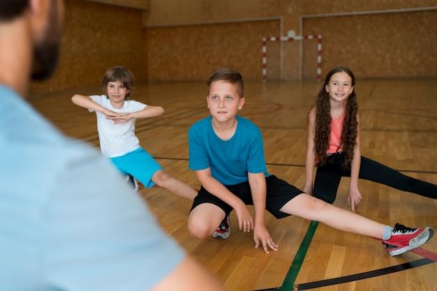 Close up kids in school gym