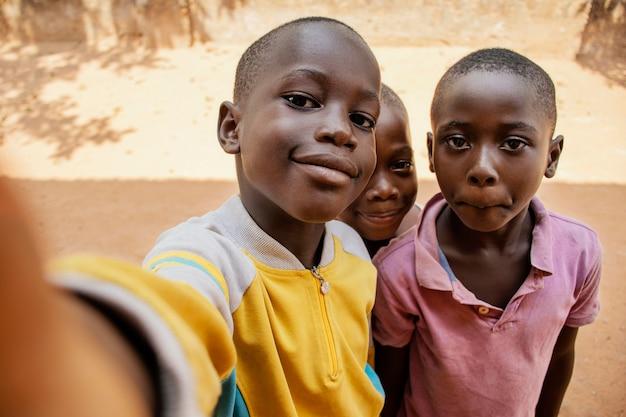 Close-up kids taking selfie together