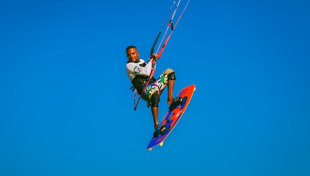 Close-up kitesurfer flying in the blue sky. egypt.