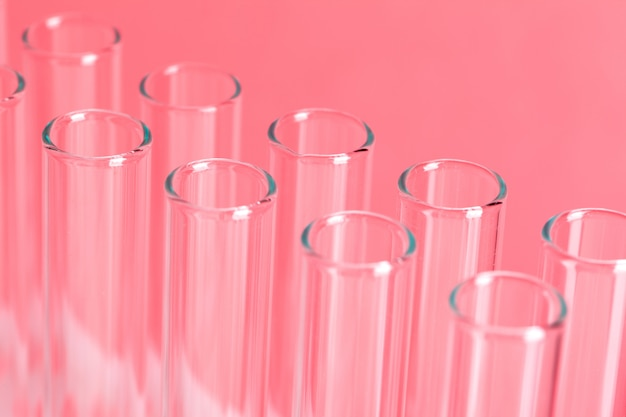 Close up laboratory test tubes on red background