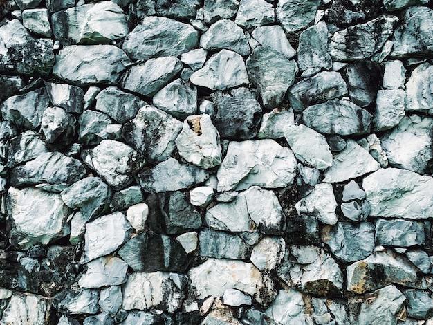 큰 회색 돌 벽 질감 배경 천연 소재를 닫습니다