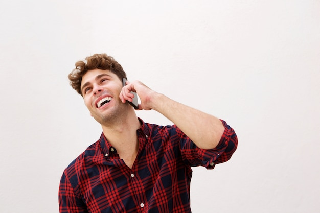 Close up laughing casual man talking on smart phone