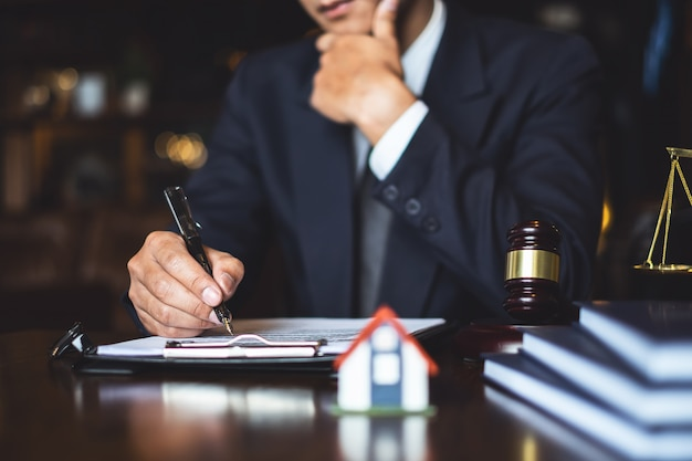 Close up lawyer businessman writing or reading contract document in office workplace for consultant lawyer concept.