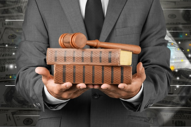 Close up lawyer with gavel judge and books