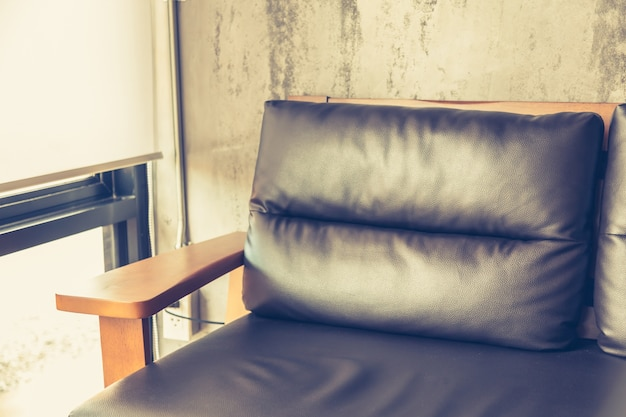 Close-up of leather and wooden armchair