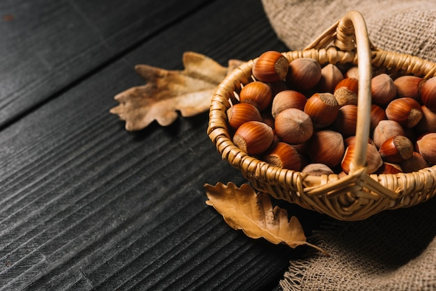Close-up leaves and hazelnuts near fabric