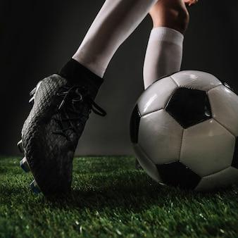 Close-up leg kicking ball
