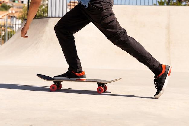 Close up leg on skateboard