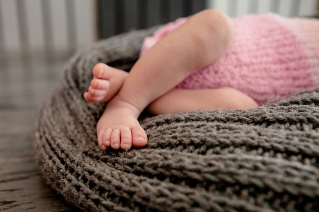 Close up on legs of baby in fluffy blanket