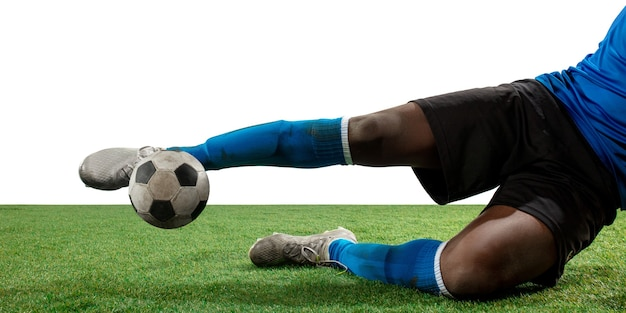 Close up legs of professional soccer, football player fighting for ball on field isolated on white background. concept of action, motion, high tensioned emotion during game. cropped image.
