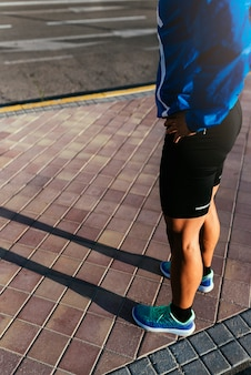 Close up of legs of runner in the city. fitness, workout, sport, lifestyle concept.